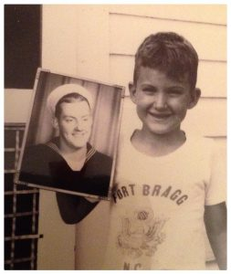 My husband Ralph's younger brother, Dan, holding his picture during the Vietnam War.